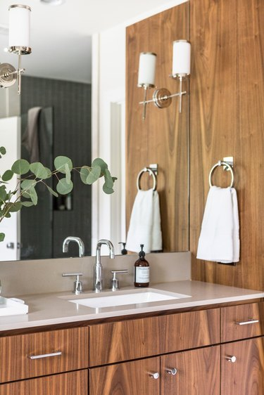 Bathroom designed by Studio Ten 25 with chrome faucet