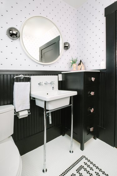 Bathroom designed by Black Lacquer Design with chrome faucet