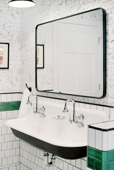 Bathroom designed by Etch Design Group with chrome faucet