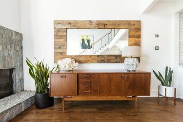 living room with fireplace and credenza
