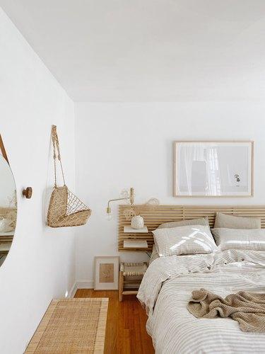 Sylvia Tribel  bedroom with IKEA headboard and brass wallsconces