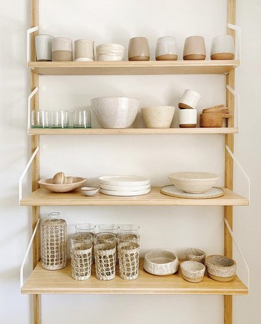 Sylvia Tribel  home with ceramic dishware on shelving