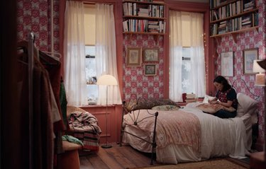 bedroom filled with books and pink decor