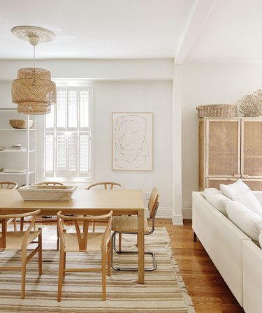 Sylvia Tribel  home dining room with Wishbone chairs and IKEA pendant