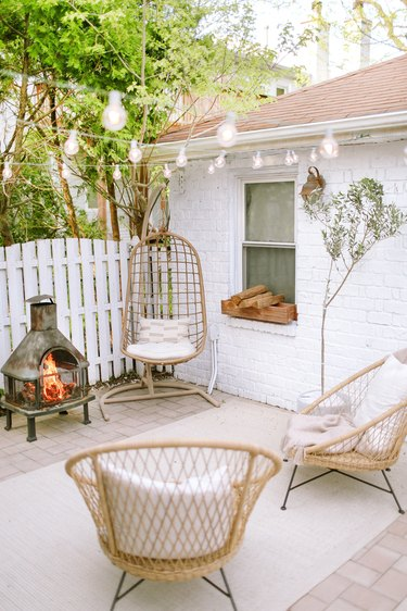 Sylvia Tribel  backyard seating area with string lights
