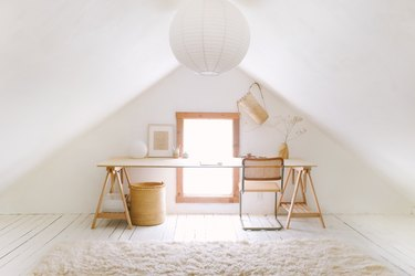 Sylvia Tribel  attic with paper pendant and plywood desk