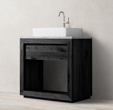 black industrial bathroom sink with white basin