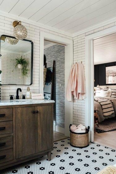 Boho Bathroom Storage in modern boho bathroom with patterned tiling and cane baskets