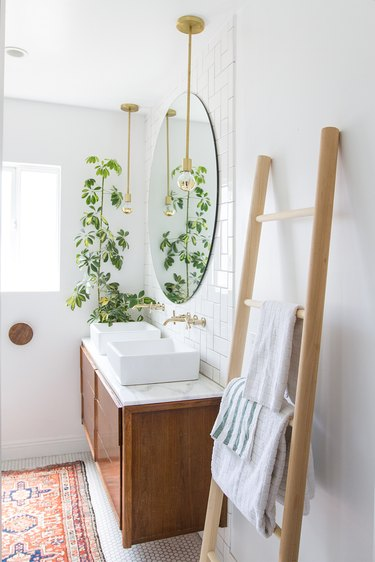subway tile in small bathroom with midcentury style