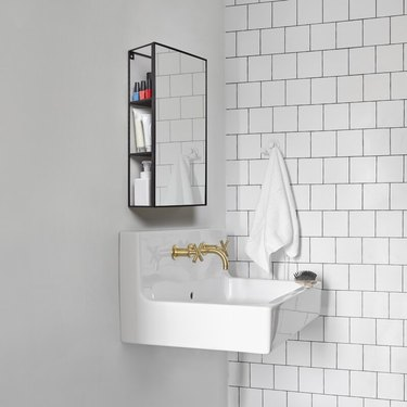 small minimalist bathroom with wall-mounted vanity that includes storage