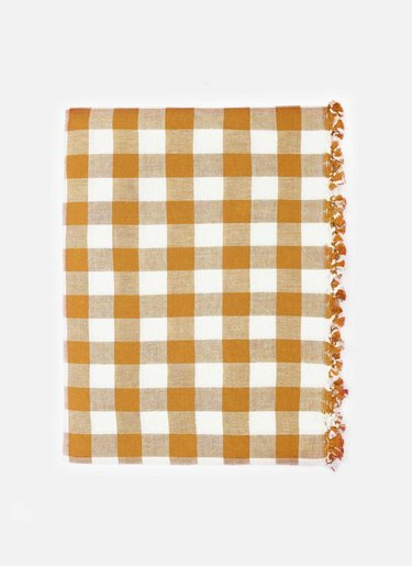 Heather Taylor Gingham Goldenrod Tablecloth, $258