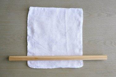 Rolling fabric unpaper towel around dowel