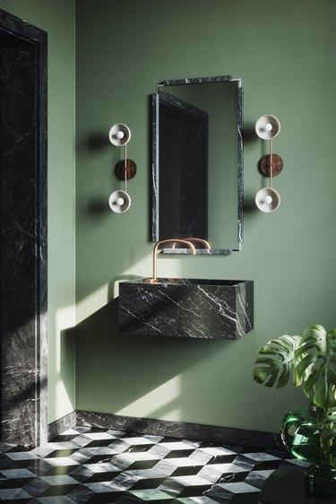 floating black marble bathroom sink in sage green bathroom