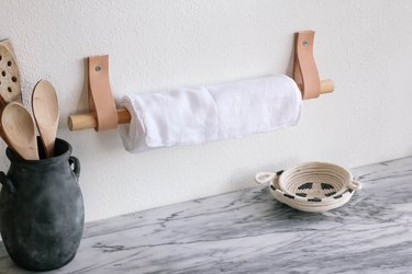 DIY unpaper towels hanging on wood and leather wall holder