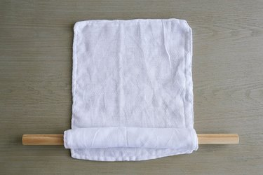 Rolling fabric unpaper towels around dowel