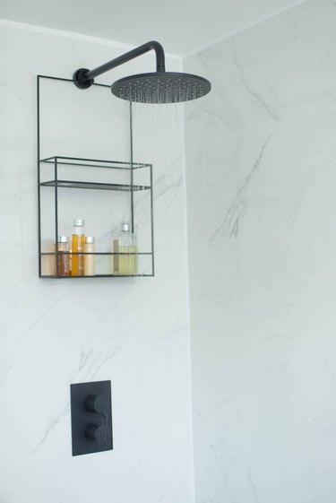 Black shower head with shower caddy and Scandinavian Bathroom Storage Ideas