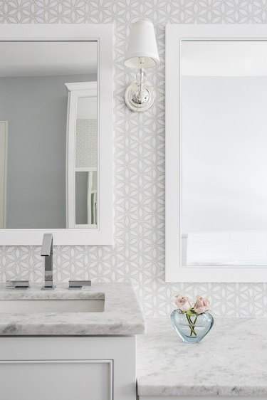 Bathroom designed by Karen B. Wolf Interiors with chrome faucet