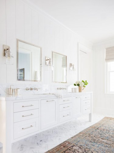Bathroom designed by Amber Interiors with chrome faucet