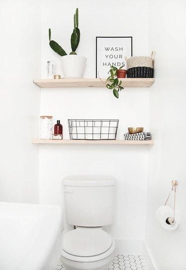 White toilet, wood shelves, plant, baskets and Scandinavian Bathroom Storage Ideas