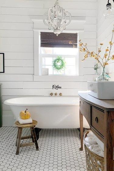 Farmhouse bathroom storage with shiplap walls and rustic decor