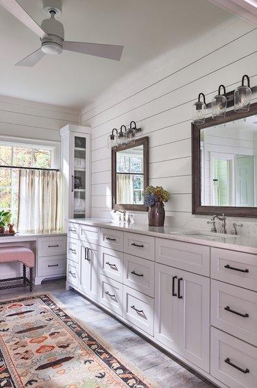Farmhouse bathroom storage by Maggie Griffin Design with storage