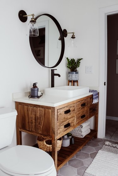 Farmhouse bathroom storage designed by Within the Grove with under the sink storage