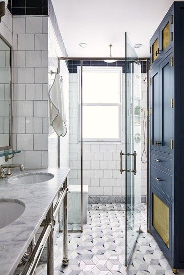 white and gray glam bathroom with semi-frameless glass shower door