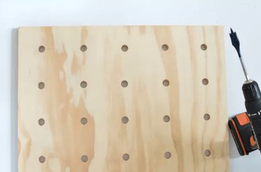 wood board with drilled holes for pegboard