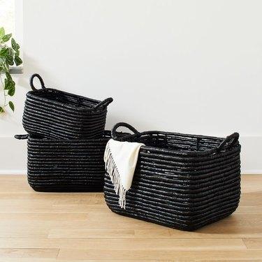 West Elm Woven Seagrass Baskets on light wood floor