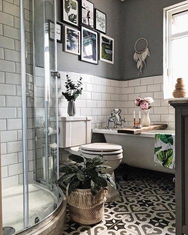 small bathroom wall art with gallery wall above clawfoot tub