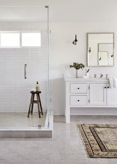 white bathroom with frameless glass shower door