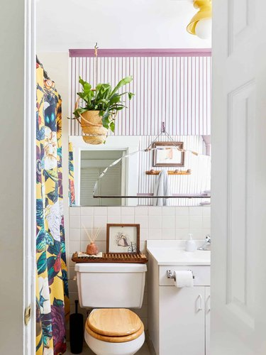 purple and white stripes wallpaper and floral shower curtain for bohemian shower