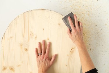 Sanding arched wood board