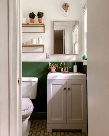 small modern bathroom with green accent wall