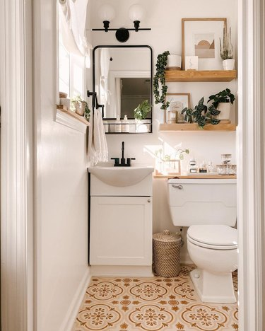 small bathroom wall art with stenciled floor and floating shelves
