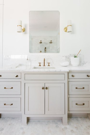 Brass Bathroom Faucet in gray white and marble bathroom with brass faucet