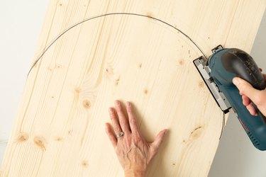 Cutting an arch into wood board