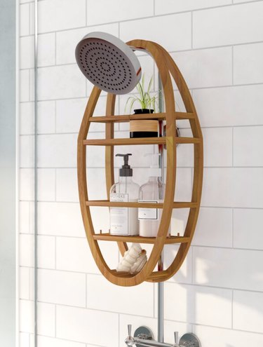 Wood best shower caddies, shower head, plant, soaps, shampoos, subway tile.