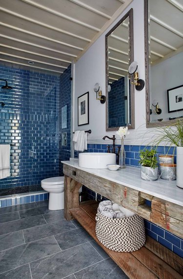 Blue shower tile in a shade of navy in farmhouse bathroom