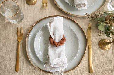 Terra cotta napkin rings on table