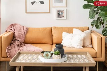 Stenciled coffee table and tan leather couch