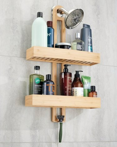 Bamboo best shower caddies, shower head, shampoo bottles, soaps.