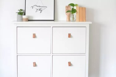 White shoe storage with leather pulls