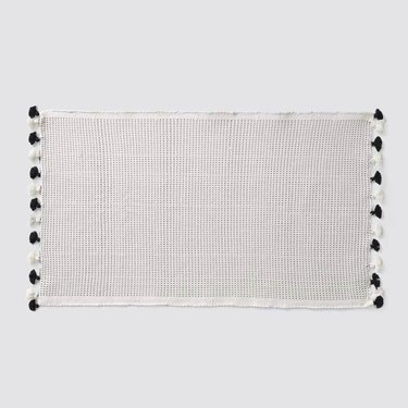 The Citizenry black and white bath mat with fringe