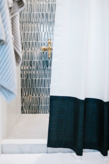 Triangle-shaped blue shower tile in midcentury modern shower