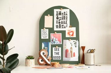 Green magnetic mood board with images and quotes