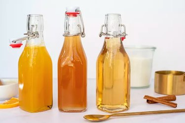 Homemade simple syrups in glass bottles