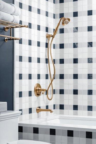 Plaid white and blue shower tile in farmhouse bathroom