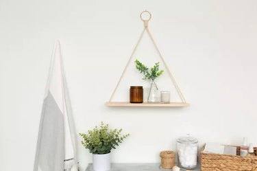Hanging wood and rope shelf