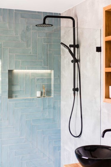 Blue shower tile in a shade of aqua in a modern shower